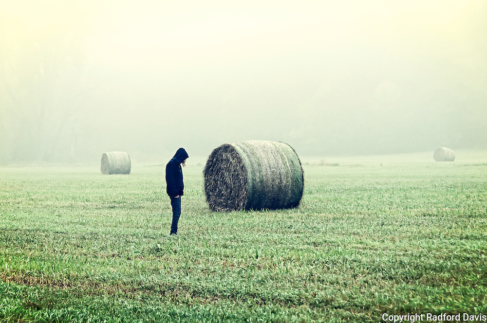 Girl in the field in the morning mist