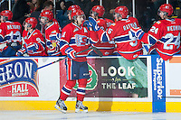 KELOWNA, CANADA -JANUARY 29: Liam Stewart C #11 of the Spokane Chiefs celebrates a goal against the Kelowna Rockets on January 29, 2014 at Prospera Place in Kelowna, British Columbia, Canada.  Stewart is the son of rock star, Rod Stewart and Sports Illustrated swimsuit model Rachel Hunter. (Photo by Marissa Baecker/Getty Images)  *** Local Caption *** Liam Stewart;