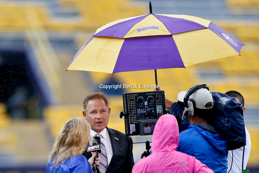 Sep 21, 2013; Baton Rouge, LA, USA; LSU Tigers head coach Les Miles is interviewed before kickoff of a game against the Auburn Tigers at Tiger Stadium. Mandatory Credit: Derick E. Hingle-USA TODAY Sports