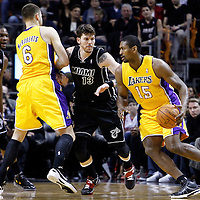 19 January 2012: Los Angeles Lakers small forward Metta World Peace (15) drives past Miami Heat shooting guard Mike Miller (13) on a screen set by Los Angeles Lakers power forward Josh McRoberts (6) during the Miami Heat 98-87 victory over the Los Angeles Lakers at the AmericanAirlines Arena, Miami, Florida, USA.