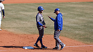 CARY, NC - MARCH 04: UMass Lowell's Ben Prada (left) is greeted by head coach Ken Harring (right) after reaching third base. The University of Massachusetts Lowell River Hawks played the University of Notre Dame Fighting Irish on March 4, 2017, at USA Baseball NTC Stadium Field in Cary, NC in a Division I College Baseball game, and part of the Irish Classic tournament. UMass Lowell won the game 8-0.