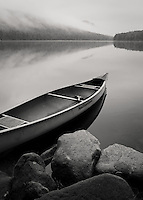 Pre-dawn light, fog and canoe on Kettle Pond in Groton State Forest, VT.