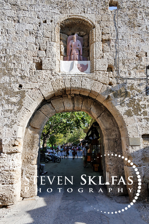 Rhodes. Greece. The arched stone gate of St Anthony inside the old walled medieval town of Rhodes. The old town is a UNESCO world heritage listed site and the best preserved, oldest and largest living medieval city in Europe.