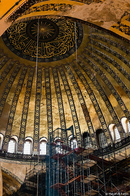 Calligraphy, mostly in the form of verses from the Koran, replaced much of the iconography in Aya Sofia's transition from church to mosque.  Here, scaffolding gives the illusion of a path to salvation.