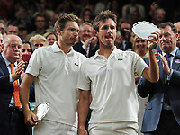 Tennis - 2019 Wimbledon Championships - Week Two, Saturday (Day Twelve)<br /> <br /> Men's Doubles Final: Nicolas Mahut (FRA) and Edouard Roger - Vasselin (FRA) and Juan Sebastan Cabal (COL) and Robert Farah (COL)<br /> <br /> Nicolas Mahut and Edouard Roger - Vasselin  with their runners up plates in the Royal box, on Centre Court <br /> <br /> COLORSPORT/ANDREW COWIE