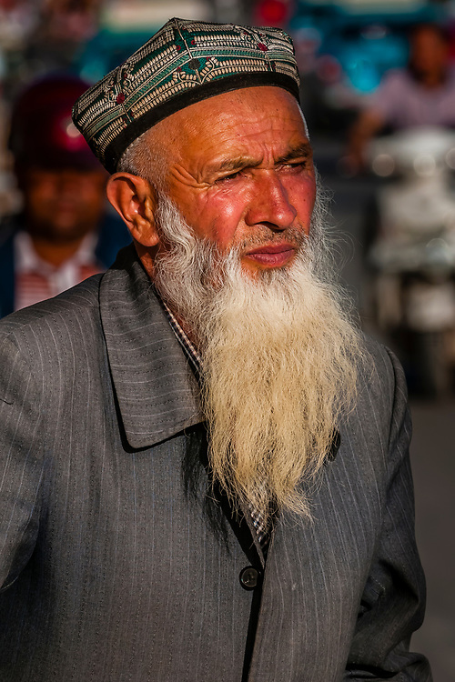 An Elderly Uyghur man, Kashgar, Xinjiang, China. Uyghur people are a Central Asian people of Muslim Turkic origin. They are China's largest minority group.