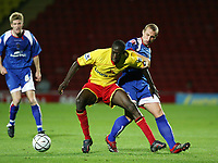 Photo: Chris Ratcliffe.<br /> Watford v Accrington Stanley. Carling Cup. 19/09/2006.<br /> Toumani Diagouraga of Watford clashes with Ian Craney (R) of Accrington Stanley.