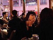 """Jeune femme, """" Chez Prune"""", rue Beaurepaire, Paris, Paris-Ile-de-France, France.<br /> Young woman, café """"Chez Prune"""", street of Beaurepaire, town of Paris, Paris-Ile-de-France region, France."""