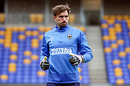 AFC Wimbledon goalkeeper Sam Walker (1) warming up prior to kick off during the EFL Sky Bet League 1 match between AFC Wimbledon and Sunderland at Plough Lane, London, United Kingdom on 16 January 2021.