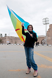 © licensed to London News Pictures. TRIPOLI, LIBYA  17/02/12. A young girl from the town of Zuwara on the Libyan coast waves an Imazighen flag in Martyrs' Square in Tripoli, Libya on the one year anniversary of the revolution. The Imazighen people are ethnic North Africans. Please see special instructions for usage rates. Photo credit should read MICHAEL GRAAE/LNP