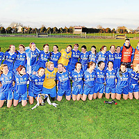21 November 2010; The West Clare Gaels, Clare, team and management of Darragh Kelly and Patrick Foley celebrate with the cup after victory over St Conleth's, Laois. Tesco All-Ireland Intermediate Ladies Football Club Championship Final, West Clare Gaels, Clare v St Conleth's, Laois, McDonagh Park, Nenagh, Co. Tipperary. Picture credit: Diarmuid Greene / SPORTSFILE *** NO REPRODUCTION FEE ***