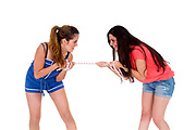 Two teens against each other in a Tug of War