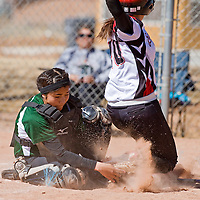 032213       Brian Leddy<br /> Wingate Bear Nizhoni Young (1) loses control of the ball while attempting to tag Grants Pirate Desiree Melonas (10) at home plate during Friday's tournament game in Grants