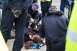 London, UK. 4 September, 2019. A Metropolitan Police cutting team take steps to arrest anti-nuclear activists who had locked themselves together using an arm tube within a shopping basket to attempt to block one of the two main access roads to ExCel London during protests on the third day of a week-long carnival of resistance against DSEI, the world's largest arms fair. The third day's protests were organised by the Campaign for Nuclear Disarmament (CND) and Trident Ploughshares.