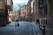 Brick Lane almost deserted due to Covid-19 on what would normally be a busy, bustling market day with hoards of people out to shop, eat and socialise on 22nd March 2020 in London, England, United Kingdom. All of the East End Sunday markets have been affected by the Coronavirus outbreak, with some completely closed and some currently partially open. Coronavirus or Covid-19 is a new respiratory illness that has not previously been seen in humans. While much or Europe has been placed into lockdown, the UK government has announced more stringent rules as part of their long term strategy, and in particular social distancing.