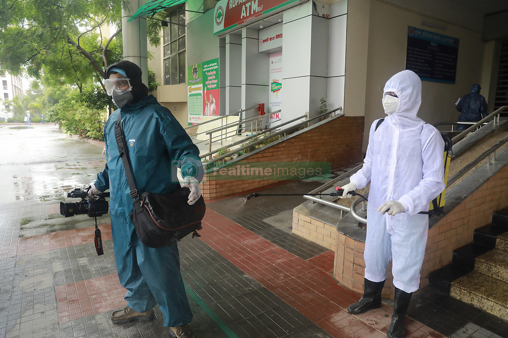 Hospital worker disinfect a journalist as he leaves the Mugda Medical College and Hospital after covering an assignment in Dhaka, Bangladesh, May 2, 2020. As many as 540 doctors have contracted Covid-19 in the country so far, accounting for a little over 6.5% of the total infections reported in the country till Friday when the number of cases climbed to 8,238. Photo by Suvra Kanti Das/ABACAPRESS.COM