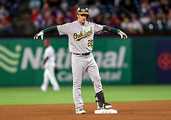 April 23, 2018 - Arlington, TX, U.S. - ARLINGTON, TX - APRIL 23: Oakland Athletics center fielder Mark Canha puts his arms up after hitting a double during the game between the Texas Rangers and the Oakland Athletics on April 23, 2018 at Globe Life Park in Arlington, Texas. (Photo by Steve Nurenberg/Icon Sportswire) (Credit Image: © Steve Nurenberg/Icon SMI via ZUMA Press)