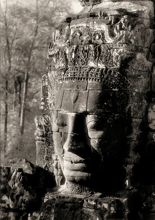 A giant carved stone face adorns a tower of the Bayon - Angkor - Siem Reap, Cambodia