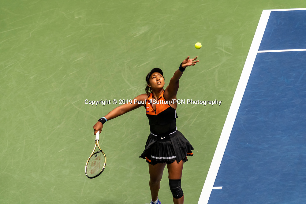 Naomi Osaka (JPN) competing in the first round of the 2019 US Open Tennis wearing her new NikeCourt x Sacai tennis outfit