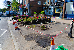 A planter box shows signs of damage as workers clear up the debris following a high speed crash involving two high performance cars on Chiselhurst High Street in South East London. London, August 22 2019.