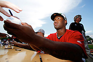 New Britain Rock Cats player Danny Santana signs a baseball before the Eastern League All-Star Home Run Derby at the Rock Cats' stadium in New Britain.