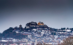 Dark clouds of a snow storm form over Stirling Castle, Scotland, united Kingdom.