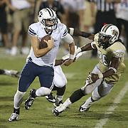 ORLANDO, FL - OCTOBER 09: Quarterback Christian Stewart #7 of the Brigham Young Cougars scrambles with the ball as Clayton Geathers #26 of the UCF Knights chases him at Bright House Networks Stadium on October 9, 2014 in Orlando, Florida. (Photo by Alex Menendez/Getty Images) *** Local Caption ***Christian Stewart; Clayton Geathers