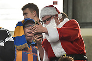 A Shrewsbury Town fan dressed as Father Christmas shows his mate his phone during the EFL Sky Bet League 1 match between Coventry City and Shrewsbury Town at the Ricoh Arena, Coventry, England on 28 April 2019.