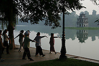 """Tai chi is popular with many Vietnamese ladies.  Hoan Kiem Lake or """"Lake of the Returned Sword"""" is located in the historical center of Hanoi, the capital of Vietnam and one of the more scenic spots in the city and also serves as a focal point for its public life, including early morning tai chi sessions."""