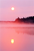 Reflection of sunrise on Childs Lake with pink fog<br />