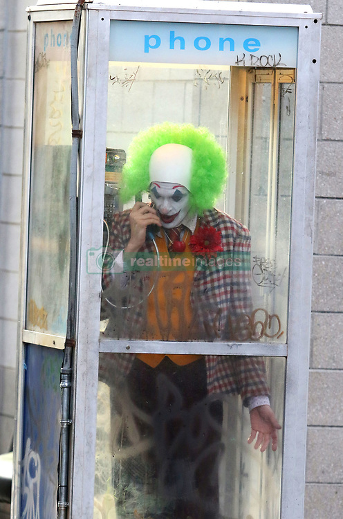 """Joaquin Phoenix cries on the scene dressed up as a clown while getting fired over the phone from """"Ha Ha Comedy Club"""" in which later on in the film he turns into the evil clown known as the """"JOKER"""". The film was being shot under the Manhattan Bridge in DUMBO Brooklyn. 24 Sep 2018 Pictured: Joaquin Phoenix. Photo credit: LRNYC / MEGA TheMegaAgency.com +1 888 505 6342"""