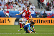 James Chester of Wales is tackled by Mical Duris of Slovakia. Euro 2016, Wales v Slovakia at Matmut Atlantique , Nouveau Stade de Bordeaux  in Bordeaux, France on Saturday 11th June 2016, pic by  Andrew Orchard, Andrew Orchard sports photography.