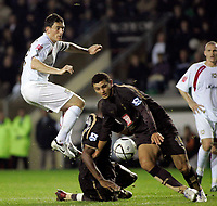 Photo: Marc Atkins.<br /> Milton Keynes Dons v Tottenham Hotspur. Carling Cup. 25/10/2006. Keith Andrews shoots on goal for Mk Dons.