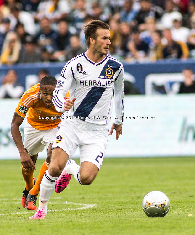 Los Angeles Galaxy star David Beckham #23 chases a ball during his farewell game in the Major League Soccer (MLS) Cup final at the Home Depot Center on December 1, 2012 in Carson, California. The Galaxy defeated Houston Dynamo 3-1 to win the MLS Cup Championship. Beckham will be leaving the team after the game. He joined the L.A. Galaxy back on January 11, 2007, when he signed a 5-year contract worth $32.5million. He has played in over 98 games during his six season stint with the Galaxy and just last season was named an MLS all-star while notching a career best 15 assists in MLS play. (Photo by Ringo Chiu/ PHOTOFORMULA.com)..