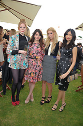 Left to right, ZOE BOYLE, OPHELIA LOVIBOND, VANESSA KIRBY and GEMMA CHAN at the Cartier Queen's Cup Polo Final, Guards Polo Club, Windsor Great Park, Berkshire, on 17th June 2012.