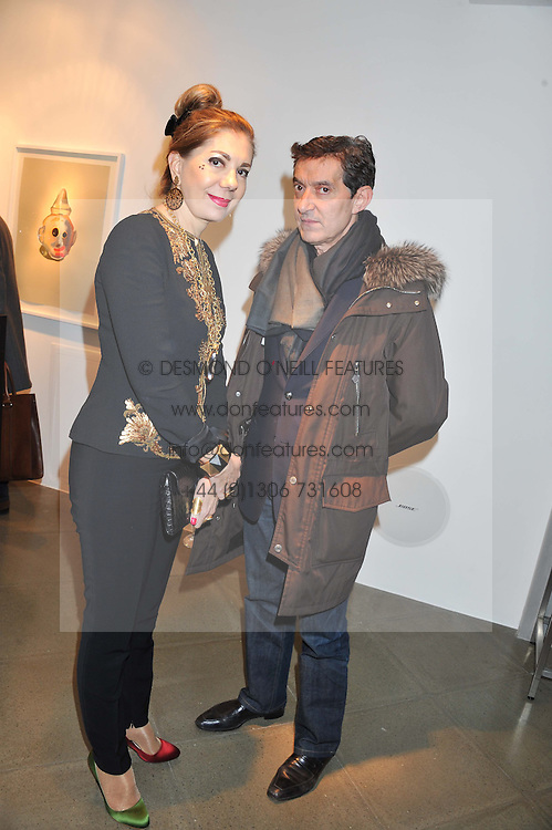 HALA FARES and DAVID GILL at a private view of jewellery by Eugenie Nairchos and Noor Fares entitled Galactic Garden held at Shizaru Mayfair, 112 Mount Street, London on 5th December 2012.