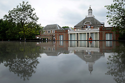 © Licensed to London News Pictures. 31/05/2012. London, UK A woman looks onto the roof of the pavilion which is designed as a pond. The press preview today 31st May 2012, of The Serpentine Gallery Pavilion 2012, designed by Herzog & De Meuron and Ai Weiwei. The pavilion is the twelfth commission in the gallery's series of annual pavilions.. Photo credit : Stephen Simpson/LNP