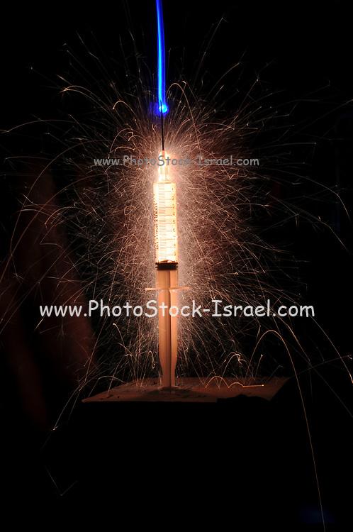 Medical science - hypodermic syringe disperses lighting and fireworks