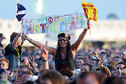 Fans watch REM play the main stage on Saturday 12 July, T in the Park 2003..
