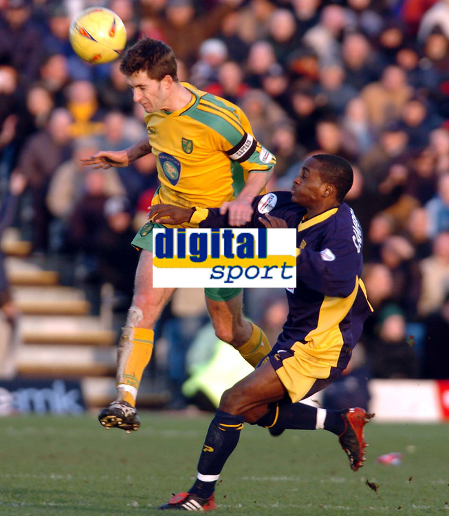 Picture: Henry Browne.<br />Date: 07/02/2004.<br />Wimbledon v Norwich City.<br /><br />Adam Drury of Norwich gets a header in ahead of Jamal Campbell Ryce of Dons.