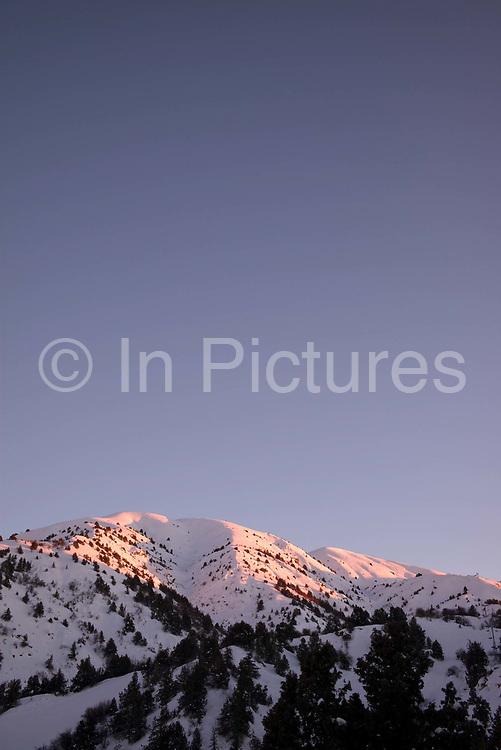 Sun down at Beldersay ski resort on 27th February 2014 in Uzbekistan.