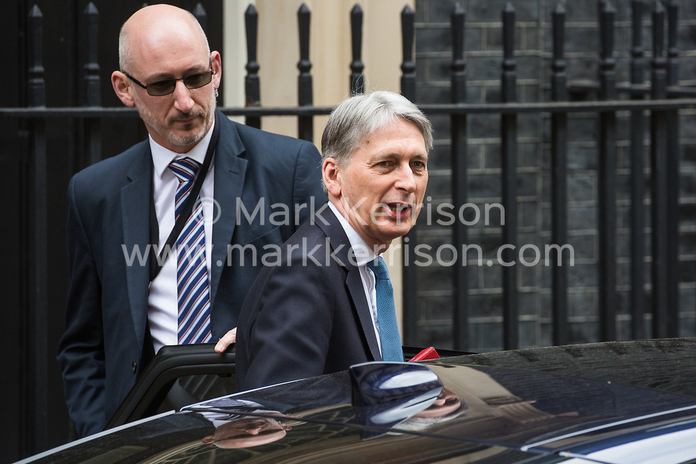 London, UK. 13th March, 2019. Chancellor of the Exchequer Philip Hammond leaves 11 Downing Street to present the Spring Statement in the House of Commons.