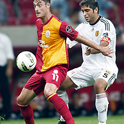 Galatasaray's Albert Riera ORTEGA (L) and Eskisehirspor's Sezgin COSKUN (R) during their Turkish Super League soccer match Galatasaray between Eskisehirspor at the TT Arena at Seyrantepe in Istanbul Turkey on Monday, 26 September 2011. Photo by TURKPIX