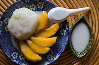 Khao Neeo Mamuang mango with sticky rice and coconut cream is a <br /> classic Thai dessert.  This classic sweet is often served as street food where it is s typically taken home as a treat for the family as it can be messy to eat on the street.  It has become popular overseas as well and a staple in any decent Thai restaurant worthy of the name.