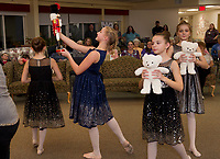 "Josephina Scoog as ""Clara"" dances with her nutcracker during the party dance scene as the Lakes Region Dance Company performs for the Taylor Home on Monday evening.  (Karen Bobotas/for the Laconia Daily Sun)"