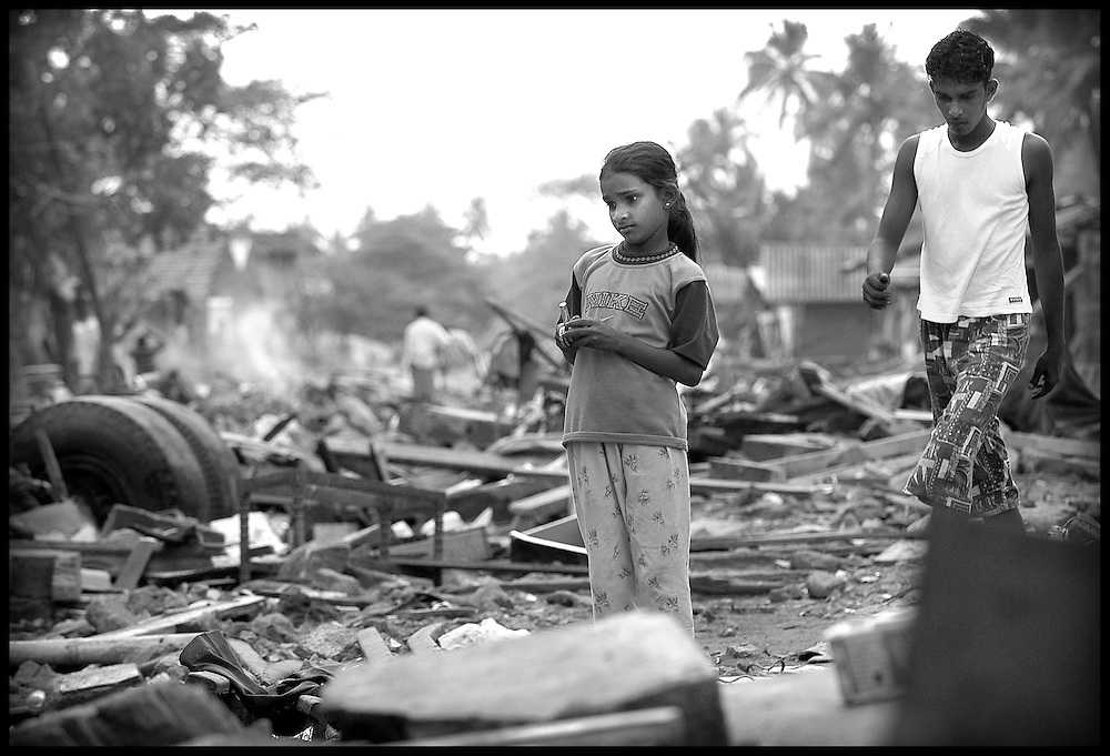 Galle , Sri Lanka 3 January 2005<br /> A girl walks among the wreckage of collapsed houses in the district of Galle, south of the country.<br /> Photo: Ezequiel Scagnetti
