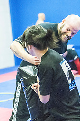 Students practising their punches with the pads as Stef Noij, KMG Instructor from the Institute Krav Maga Netherlands, takes the IKMS G Level Programme seminar today at the Scottish Martial Arts Centre, Alloa.