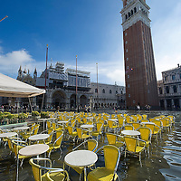 VENICE, ITALY - NOVEMBER 05:  A general view of Saint Mark's Square during today Acqua Alta on November 5, 2013 in Venice, Italy. The high tide, or acqua alta as it is locally known, is a natural event most commonly affecting the city during Autumn and Winter.  (Photo by Marco Secchi/Getty Images)