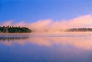 Fog at sunrise on Child's Lake<br />Duck Mountain Provincal Park<br />Manitoba<br />Canada