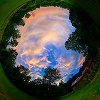 Inverse Little Planet View of an Evening Rainbow. After the Thunderstorm. Composite of 46 images taken with a Nikon D810a camera and 8-15 mm fisheye lens (ISO 200, 8 mm, f/8, 1/200 sec). Raw images processed with Capture One Pro and AutoPano Giga.
